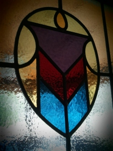 The stained glass in the porch door.