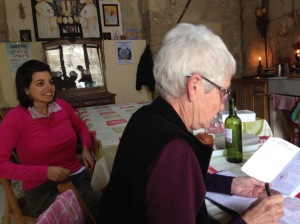 Sylvia registering (a much happier) Rebecca in the kitchen at San Antón.